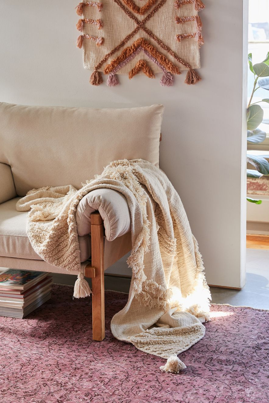 Tufted throw blanket and textured wall hanging