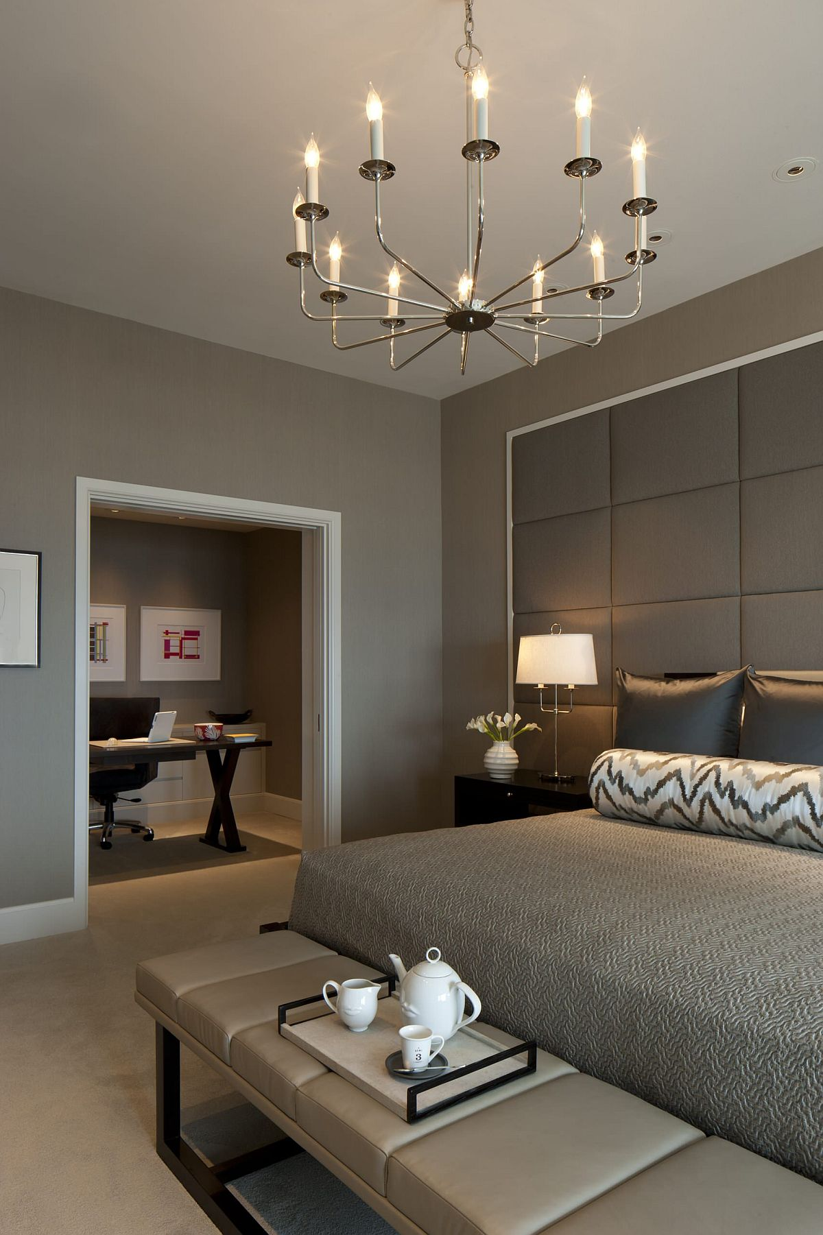 Tufted wall-covering in gray perfectly captures tone-on-tone approach to decorating with gray in this bedroom