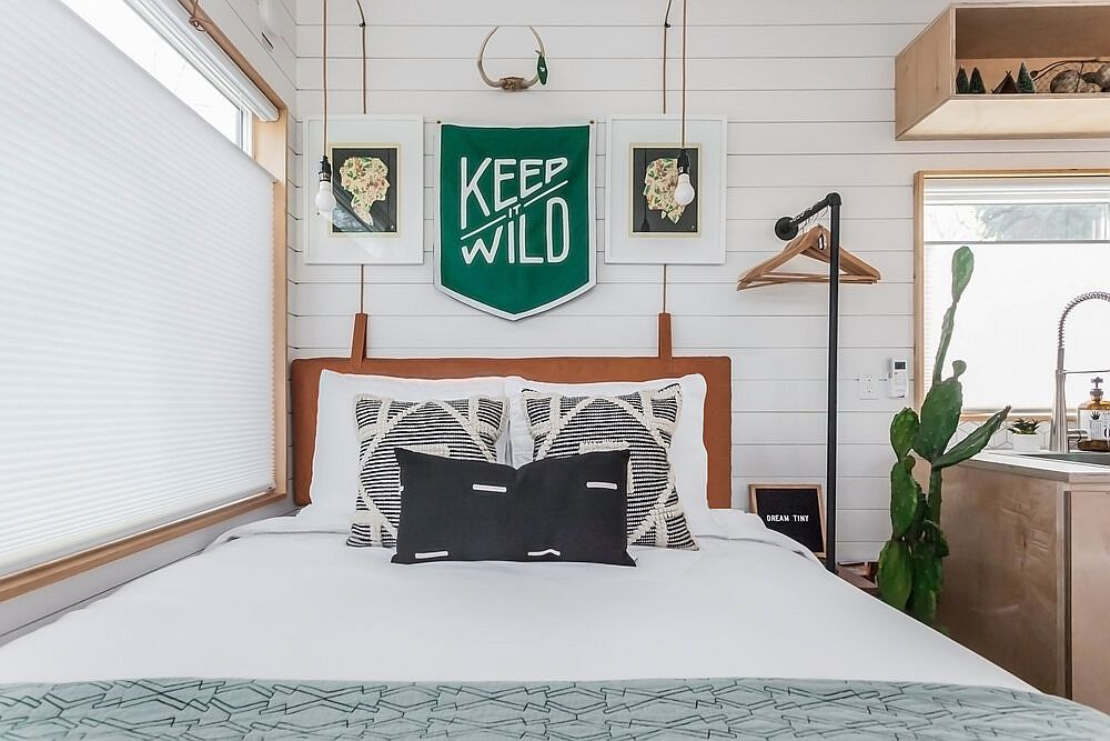 Ultra-small bedroom of the tiny house with ample natural light and a space-savvy design