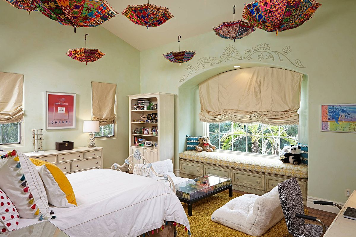 Umbrellas hanging from the ceiling add color and whimsical charm to this cool teen bedroom