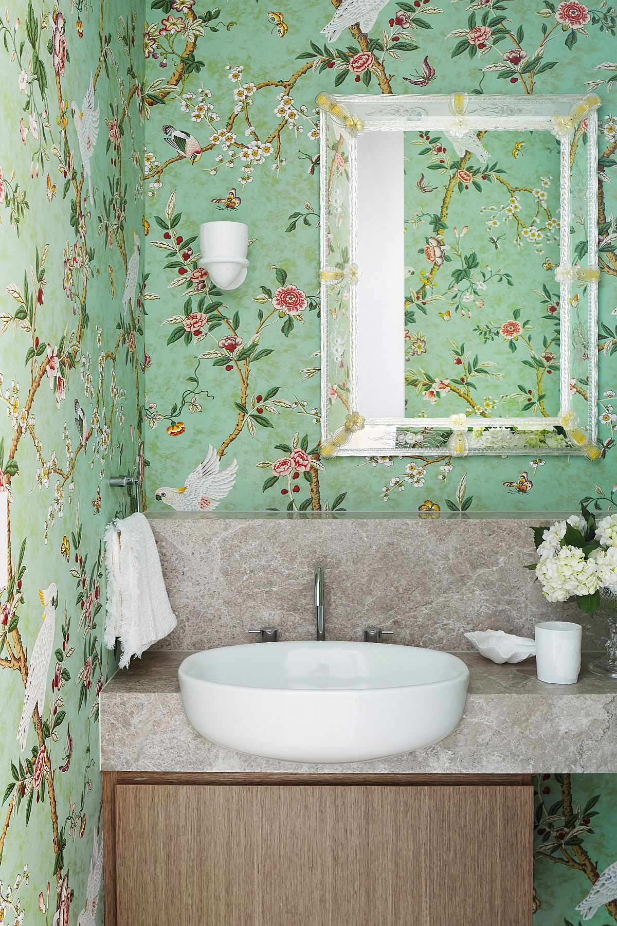 Use wallpaper with nature-inspired themes to add light green to the powder room