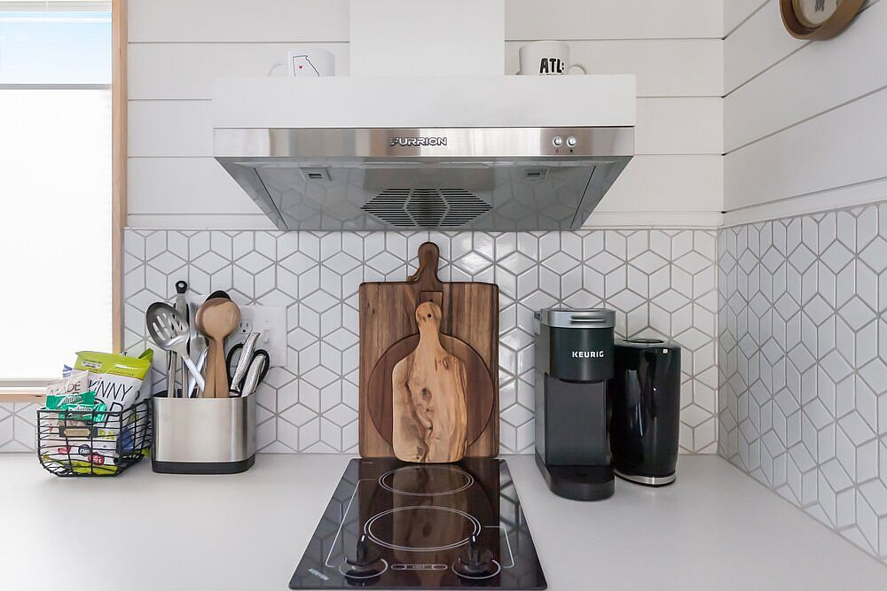 Using geometric tiles for the backsplash in the kitchen