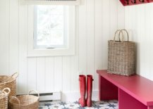 White-mudroom-with-beach-and-cottage-styles-features-patterned-floor-tiles-and-bright-pink-bench-78922-217x155