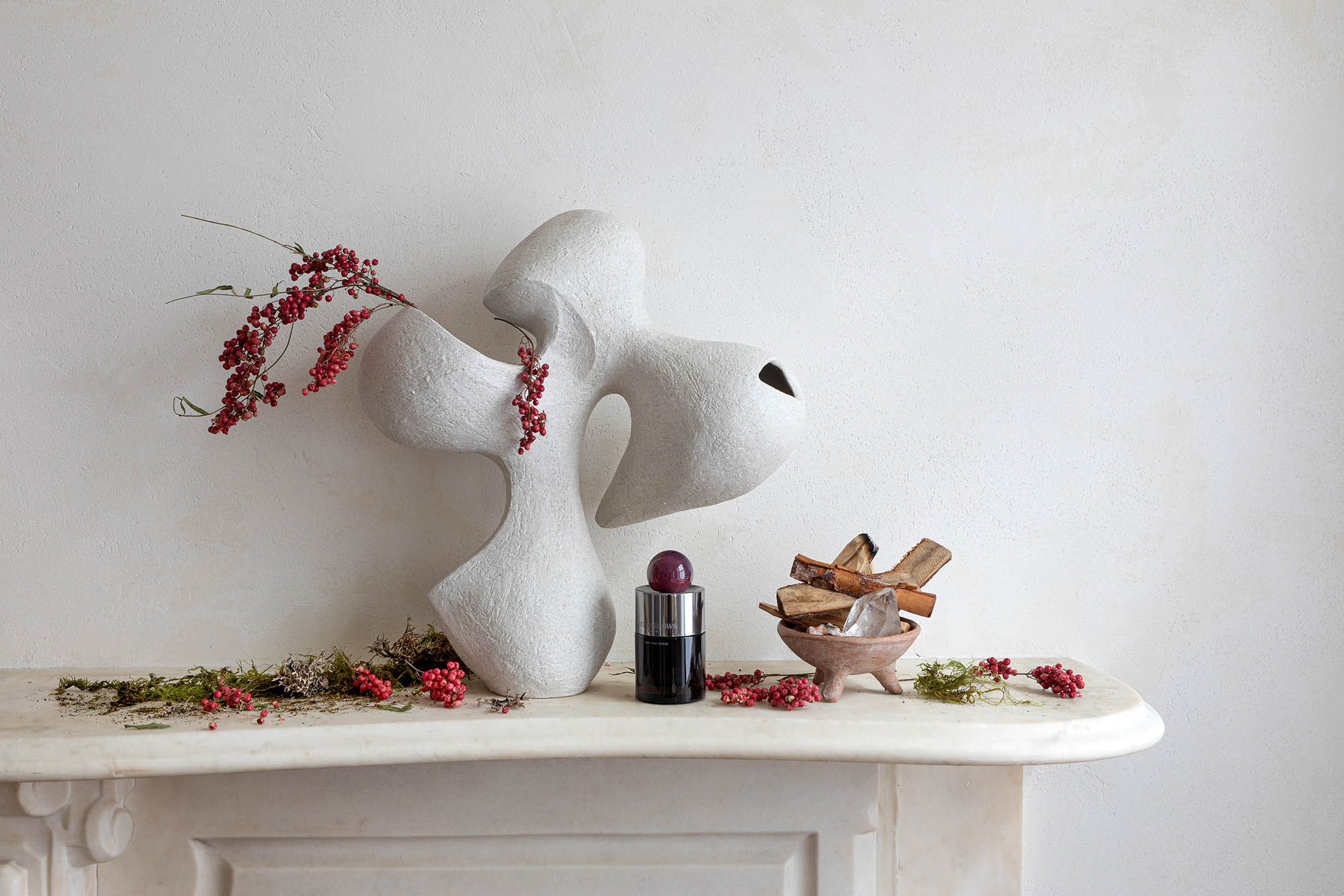 White sculpture on a fireplace mantel