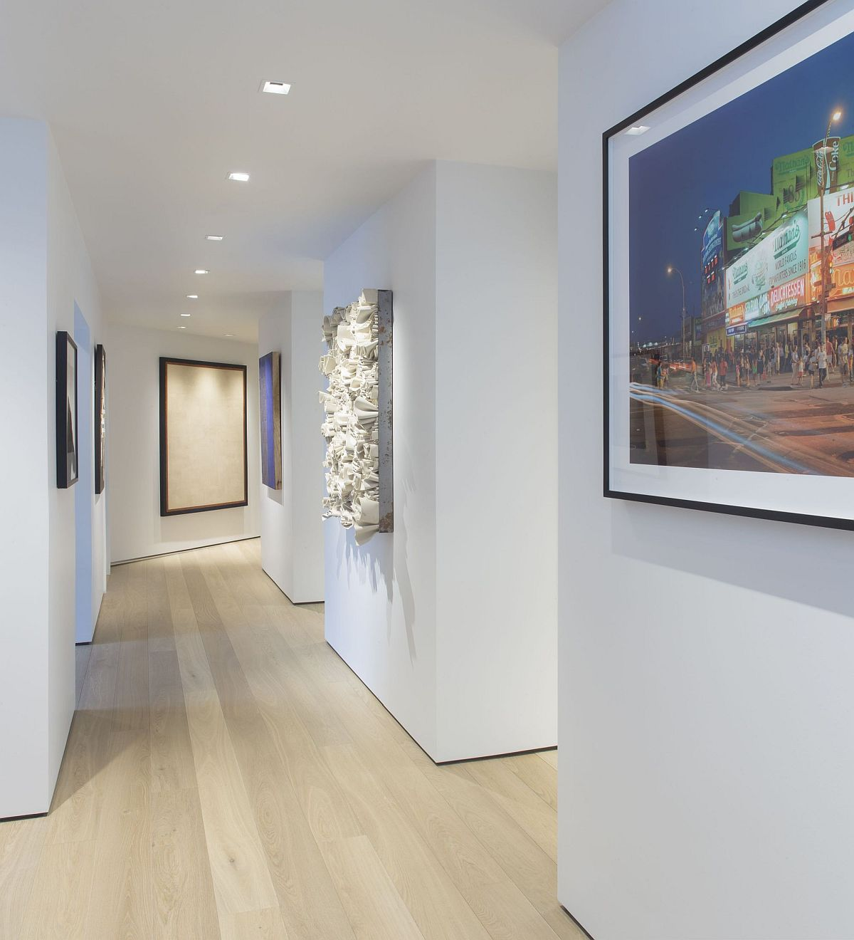 White walls in the hallways act as a gallery-style setting for the art work to be displayed