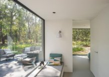 Window-seat-next-to-the-large-window-allows-those-inside-to-enjoy-the-green-landscape-outside-21912-217x155