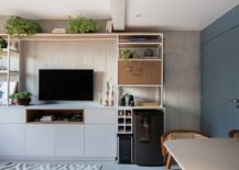 Wood-and-metal-bookcase-on-one-side-of-the-floor-with-TV-beer-cooler-and-ample-space-for-other-features-15361-217x155