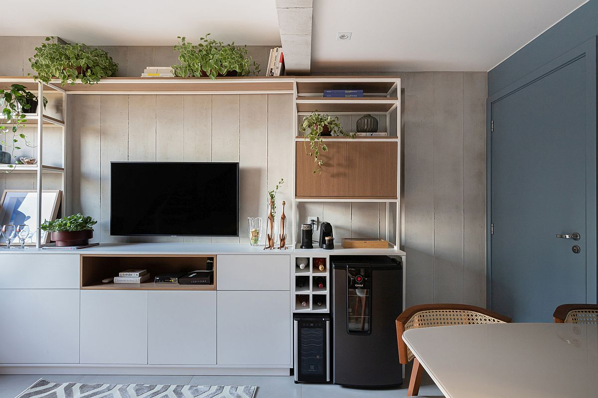 Wood and metal bookcase on one side of the floor with TV, beer cooler and ample space for other features