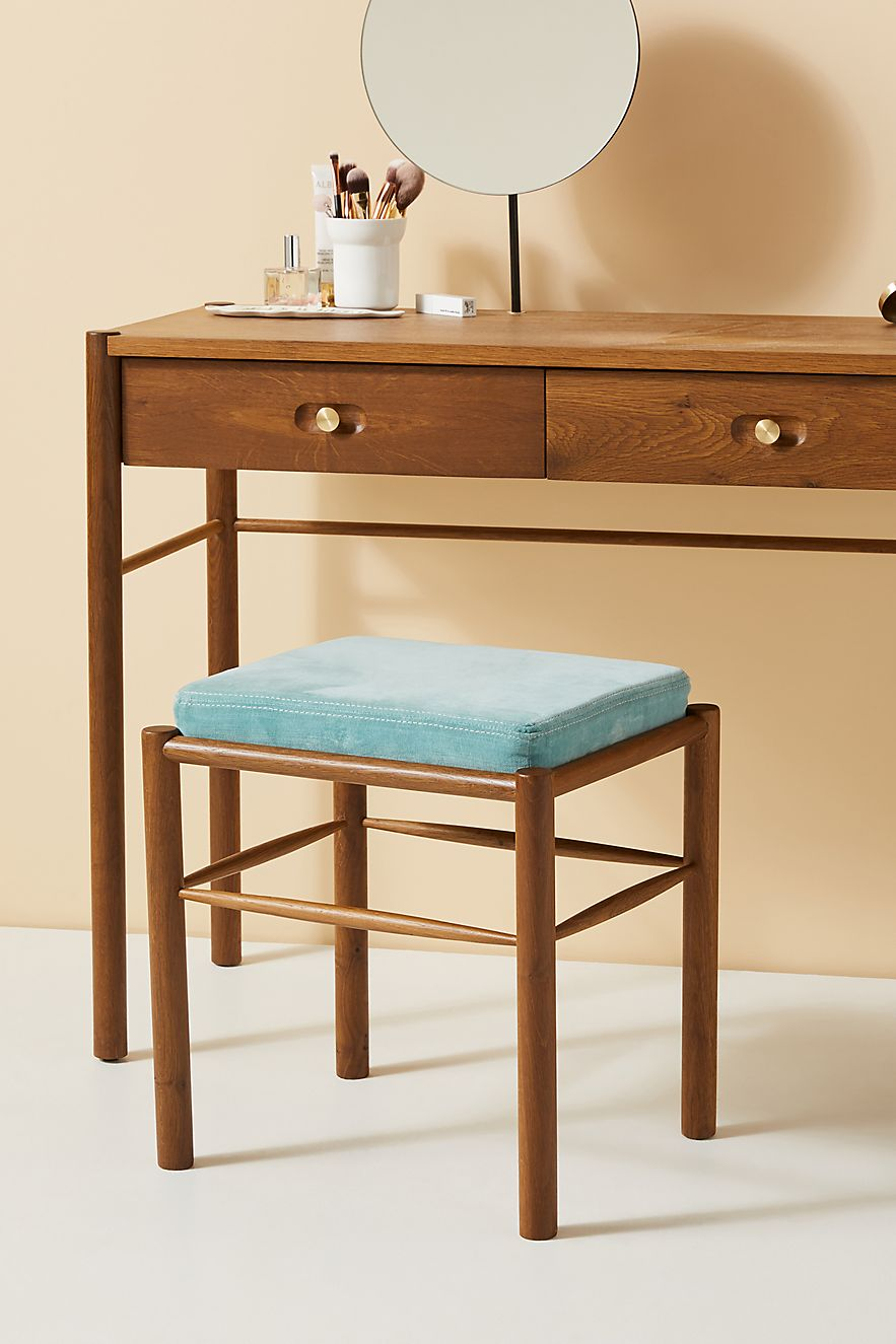 Wood vanity stool with a blue cushion