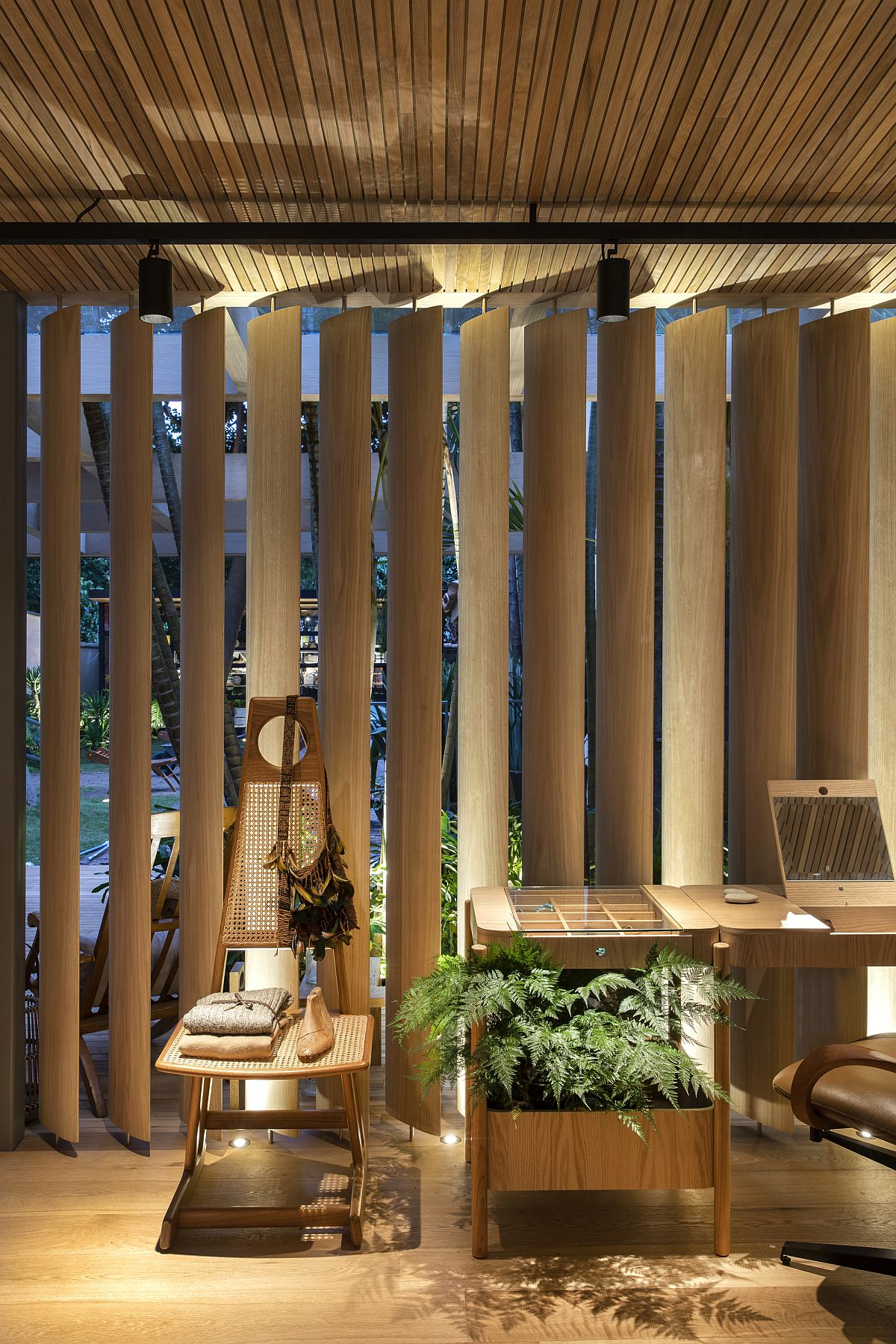 Wooden brise soleils and frames create a beautiful backdrop in the Forest House