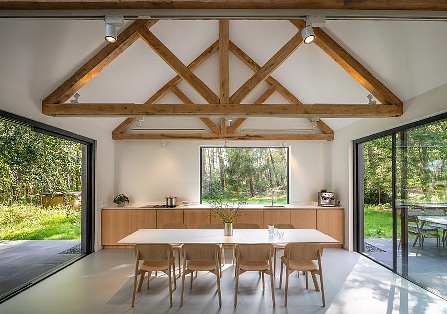 Wooden ceiling beams add support to the structure while offering textural contrast to the interior