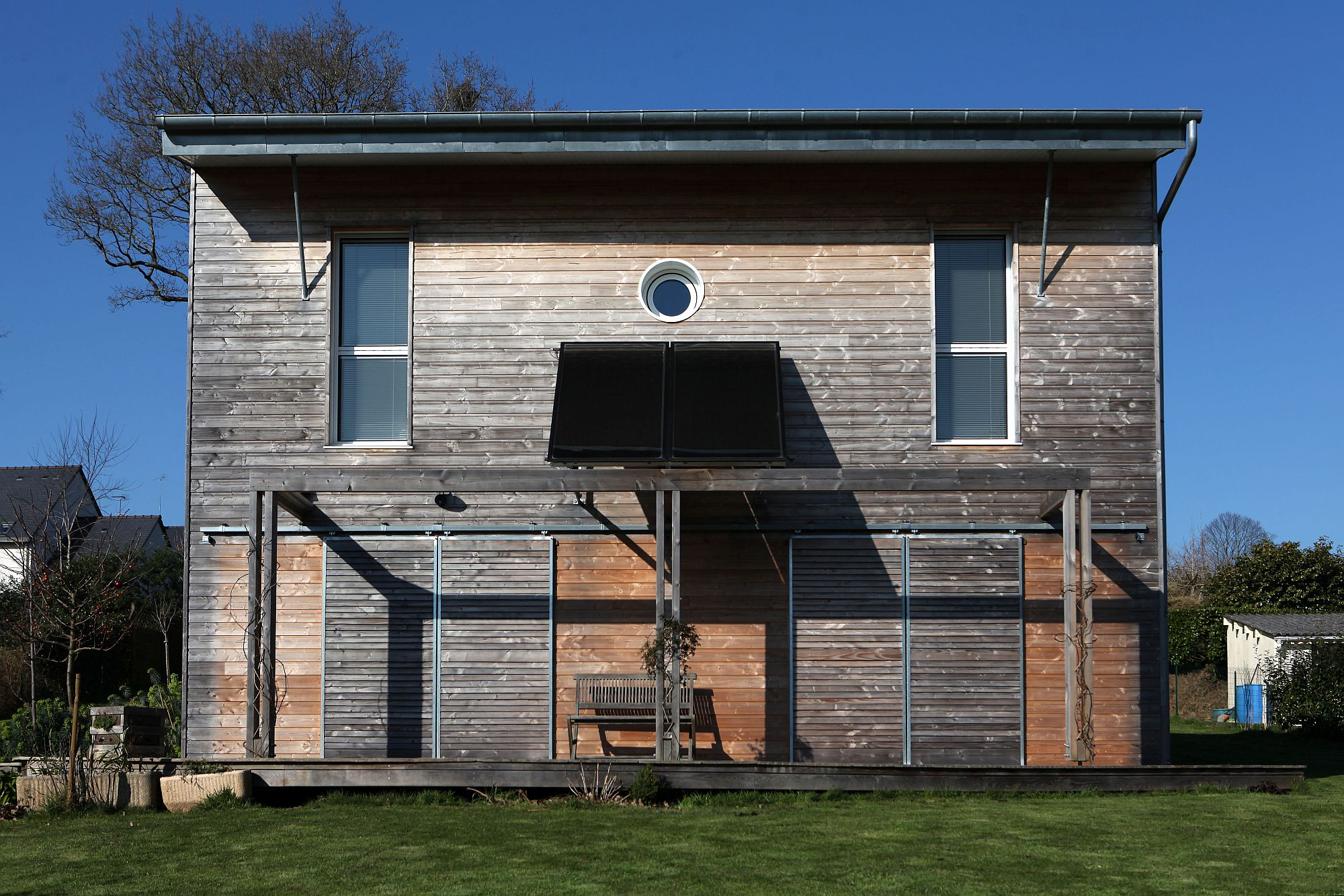 Wooden exterior of the French house with modern sustainable design