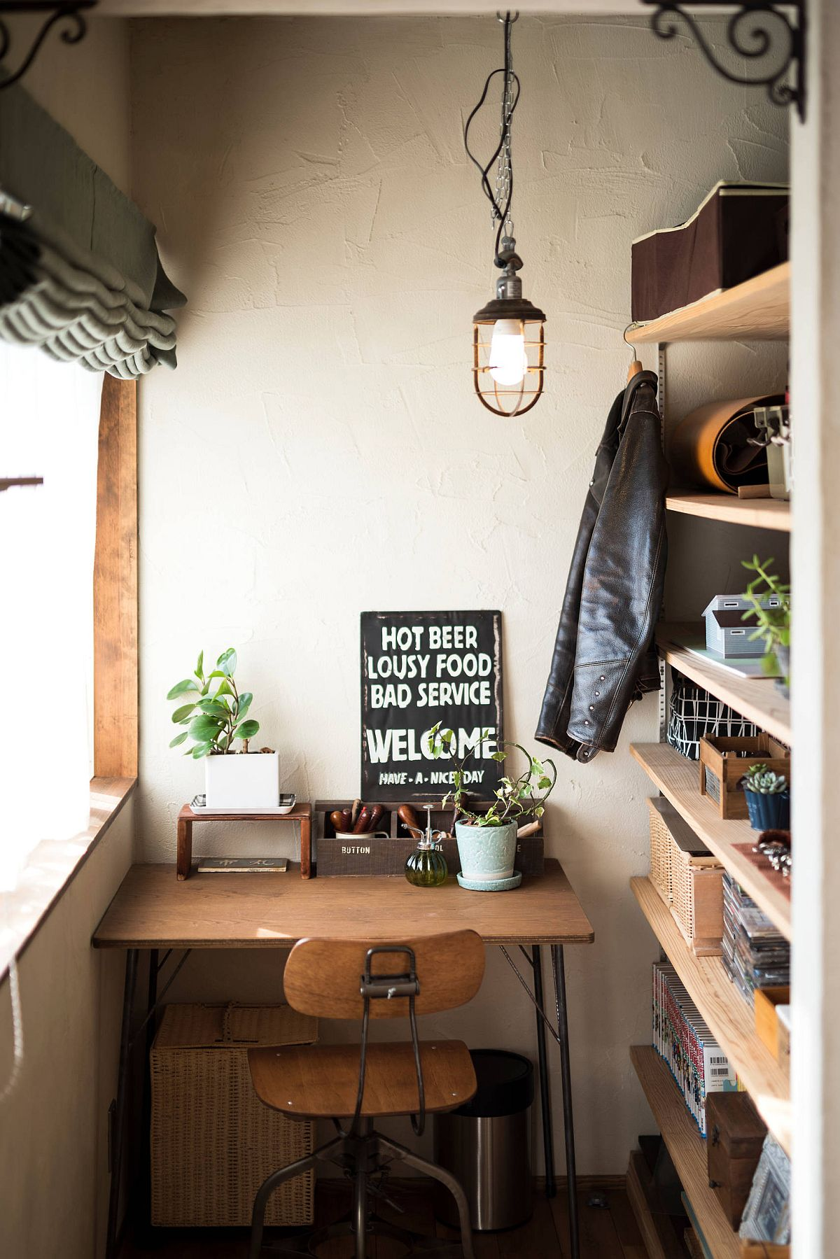 Wooden shelves and desk in the tiny eclectic home office offer smart functionality