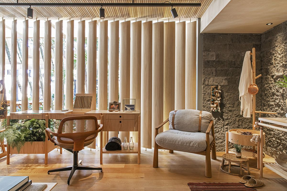 Wooden slats and brise soleils bring the outdoors inside at this exquisite and unique home