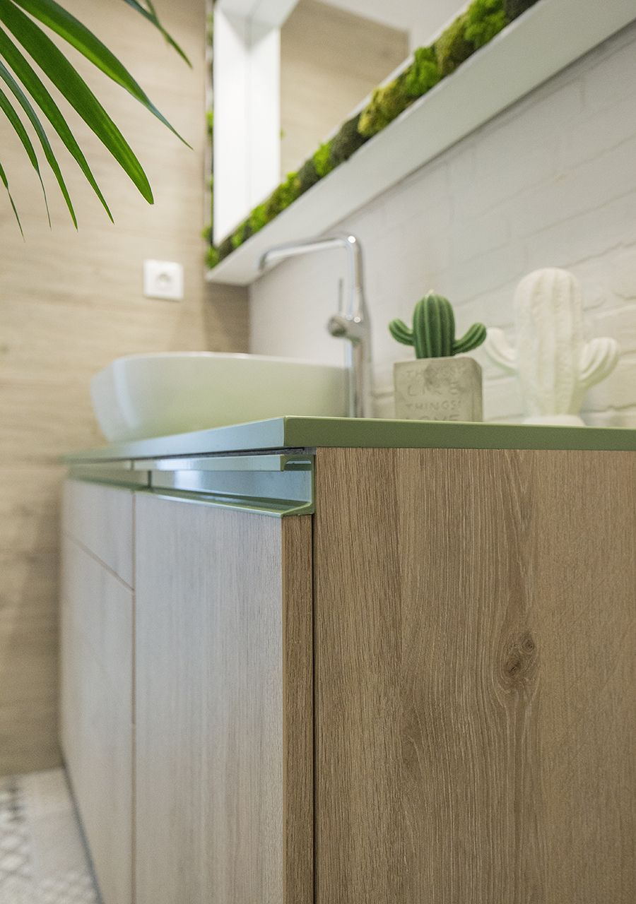 Wooden vanity for the modern bathroom with green countertop