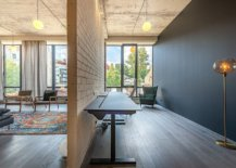 Workspace-with-polished-dark-gray-walls-adds-modernity-to-the-industrial-apartment-that-was-once-a-warehouse-44120-217x155