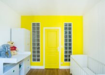 Yellow-accent-wall-and-door-create-a-stunning-visual-focal-point-in-this-contemporary-Paris-nursery-12801-217x155
