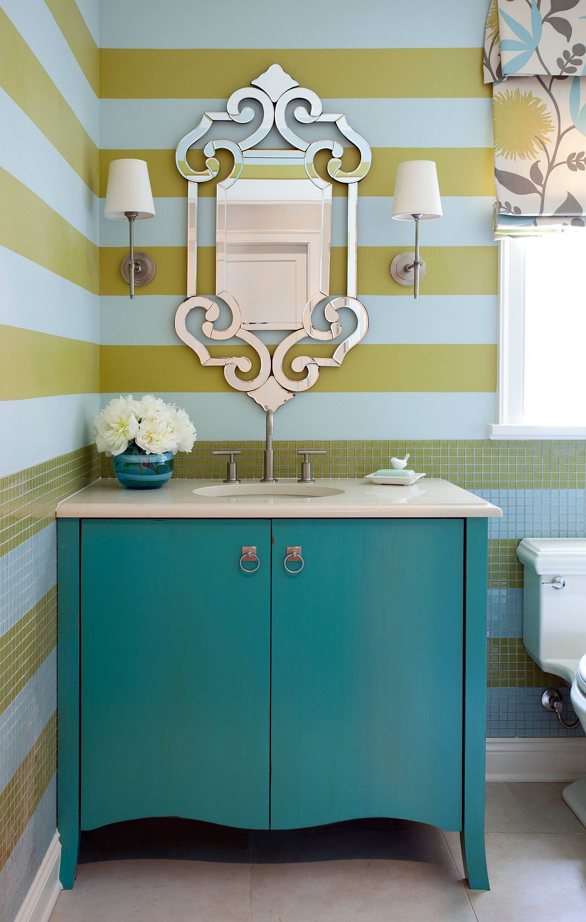 Yellow and blue stripes shape the backdrop in the contemporary powder room