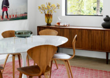 Adapting-a-mid-century-modern-style-allows-you-to-try-out-iconic-decor-pieces-like-the-curvy-Cherner-chair-45781-217x155