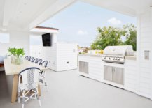 Awesome-rooftop-outdoor-kitchen-with-a-cheerful-beach-style-and-a-covered-dining-space-next-to-it-45711-217x155