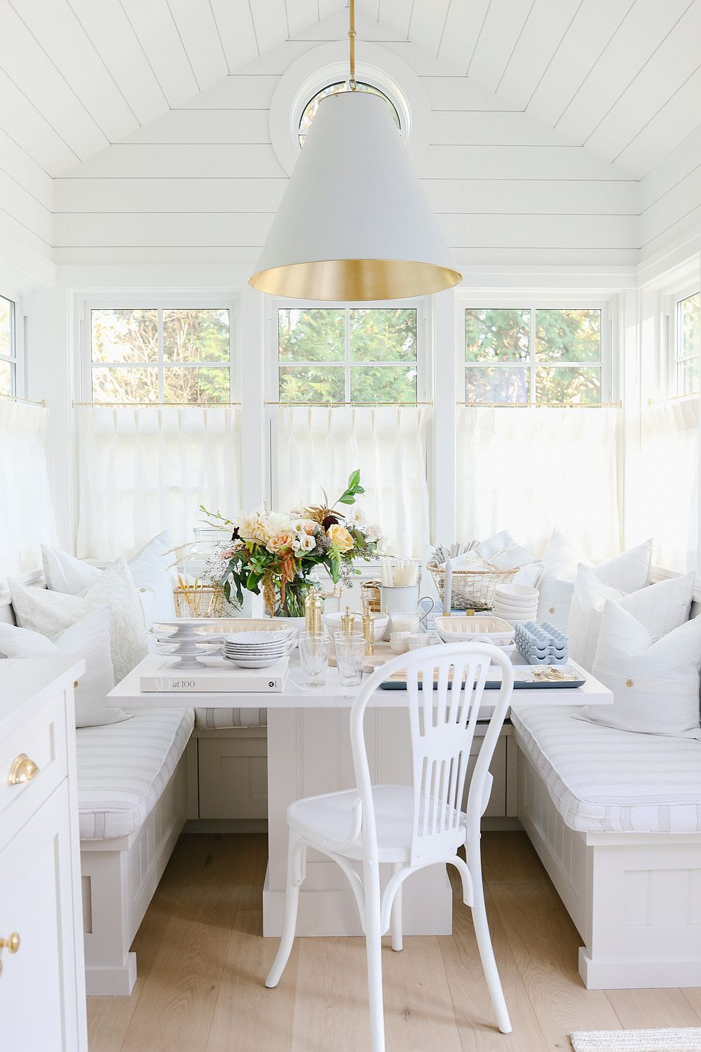 Banquette style seating for the shabby chic dining space that is space-savvy
