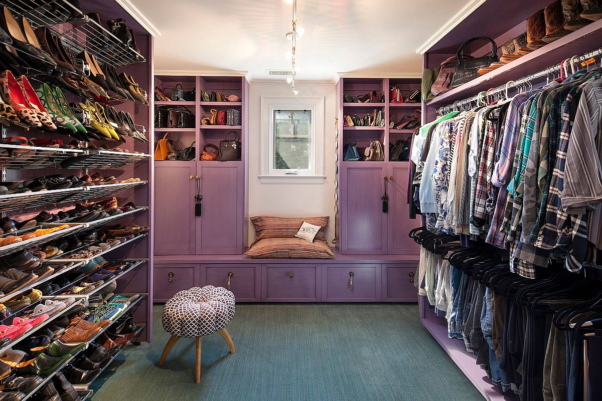 Beautiful purple cabinets have been coupled with series of open shelves and hangers in this lovely eclectic walk-in closet