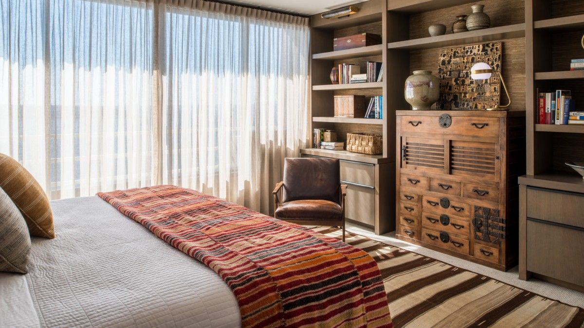 Bedroom of Downtown Seattle apartment designed for a Alaskan bachelor