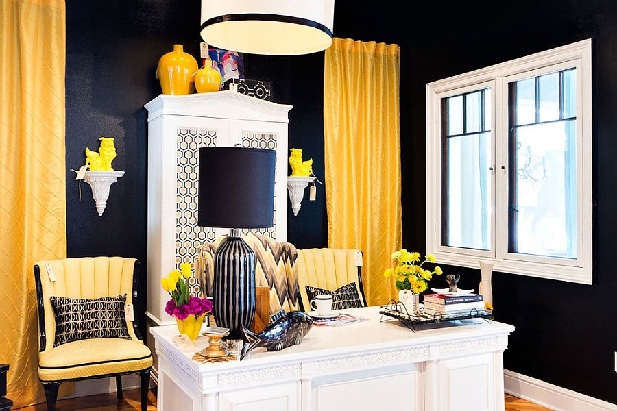 Black walls in this home office accentuate the brilliant yellow accents and limited use of white