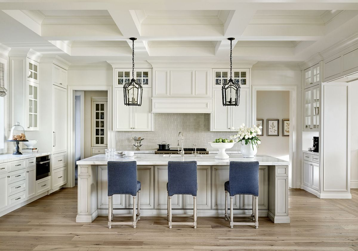Blue accent bar chairs for the modern kitchen in white with plenty of storage space