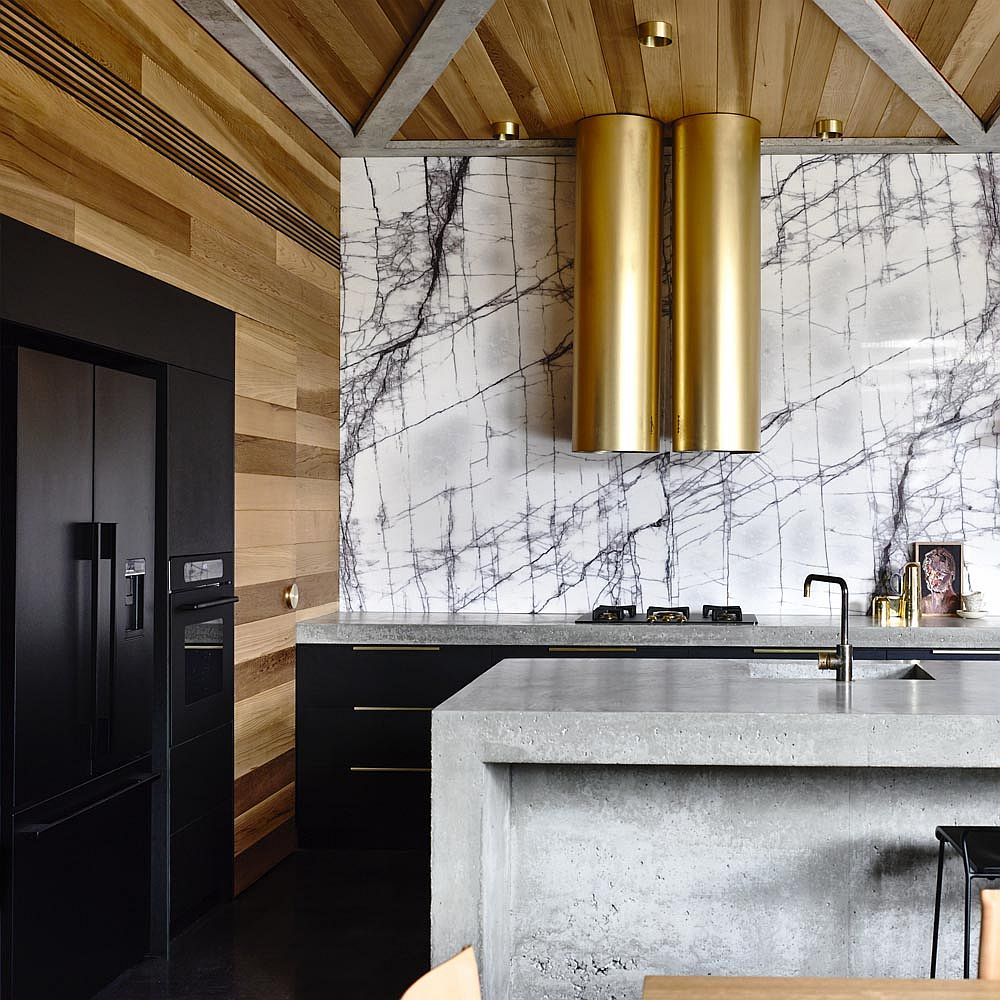 Bold metallic hoods along with marble backsplash in the kitchen shape a lovely focal point