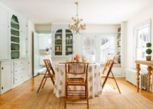 Classy-shabby-chic-dining-space-with-a-round-dining-table-and-ample-shelving-in-the-backdrop-36006-217x155