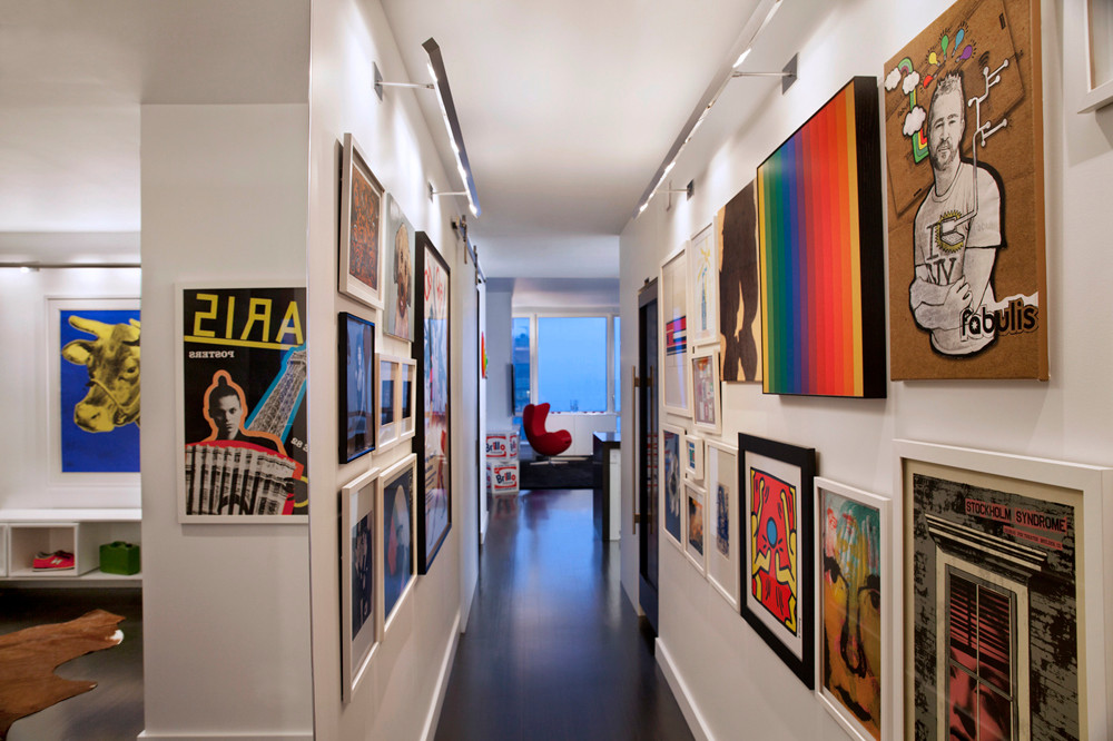 Colorful wall art pieces create a gorgeous hallway display that steals the spotlight