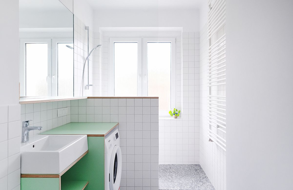 Combine the laundry and the bathroom with smart design and a hint of color