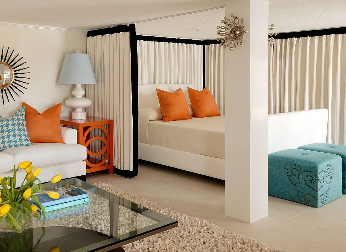 Contemporary bedroom in white with lovely blue and orange accents all around