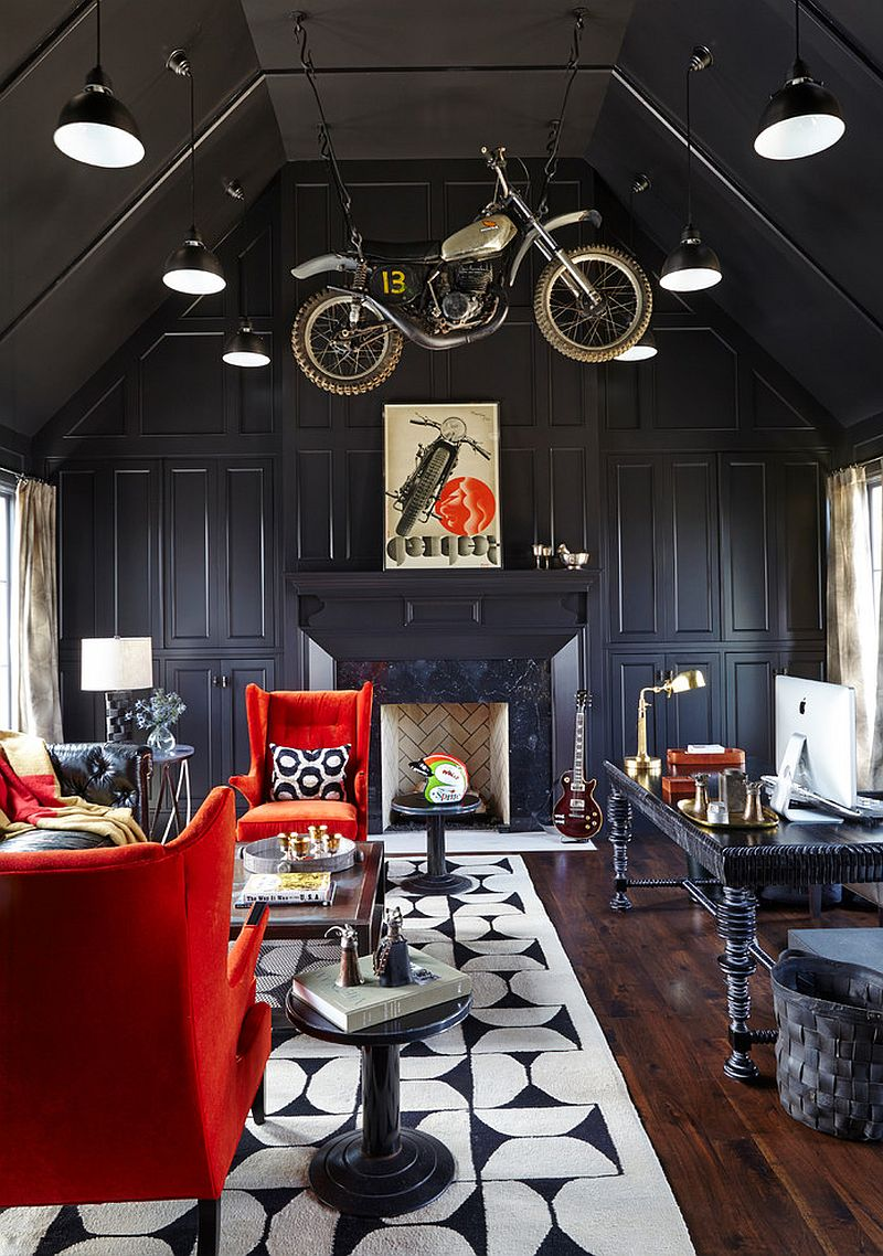 Contemporary home office in black with bold red accents brought in by comfortable chairs