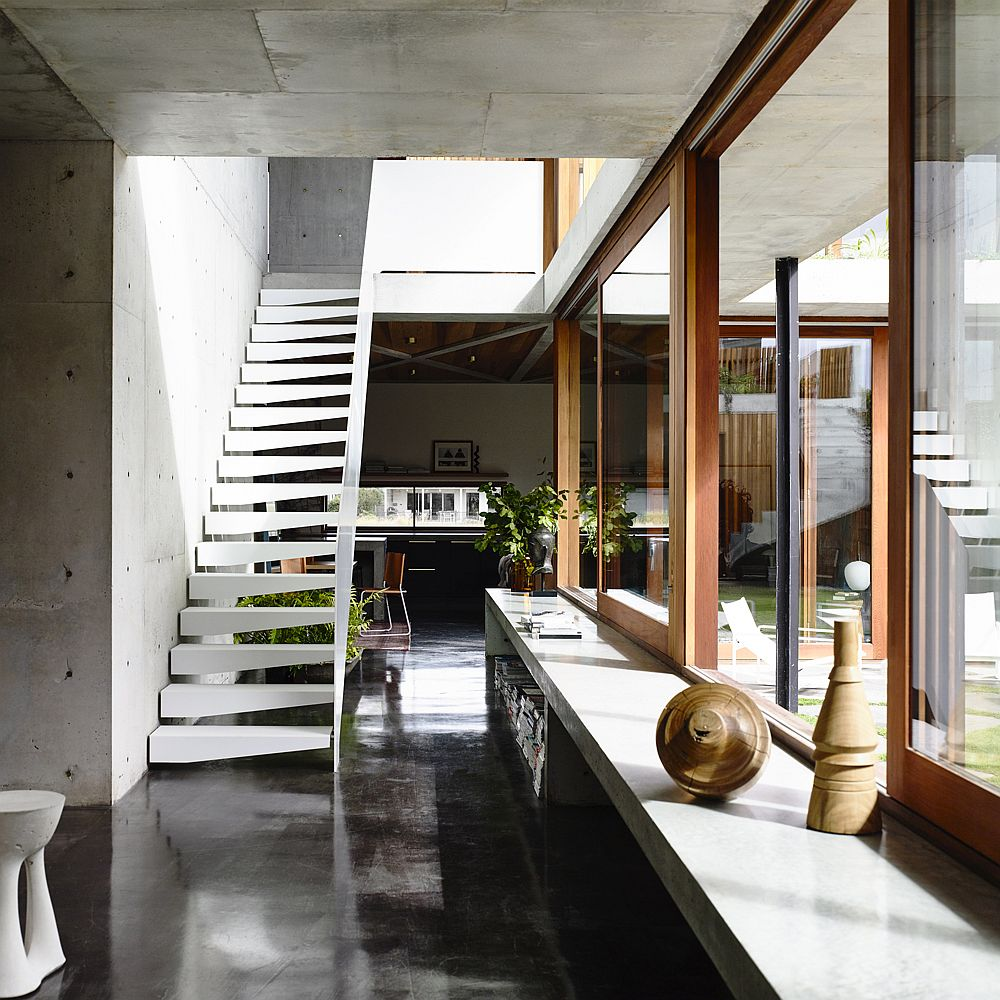Contemporary staircase inside the house leads to the upper level of the house