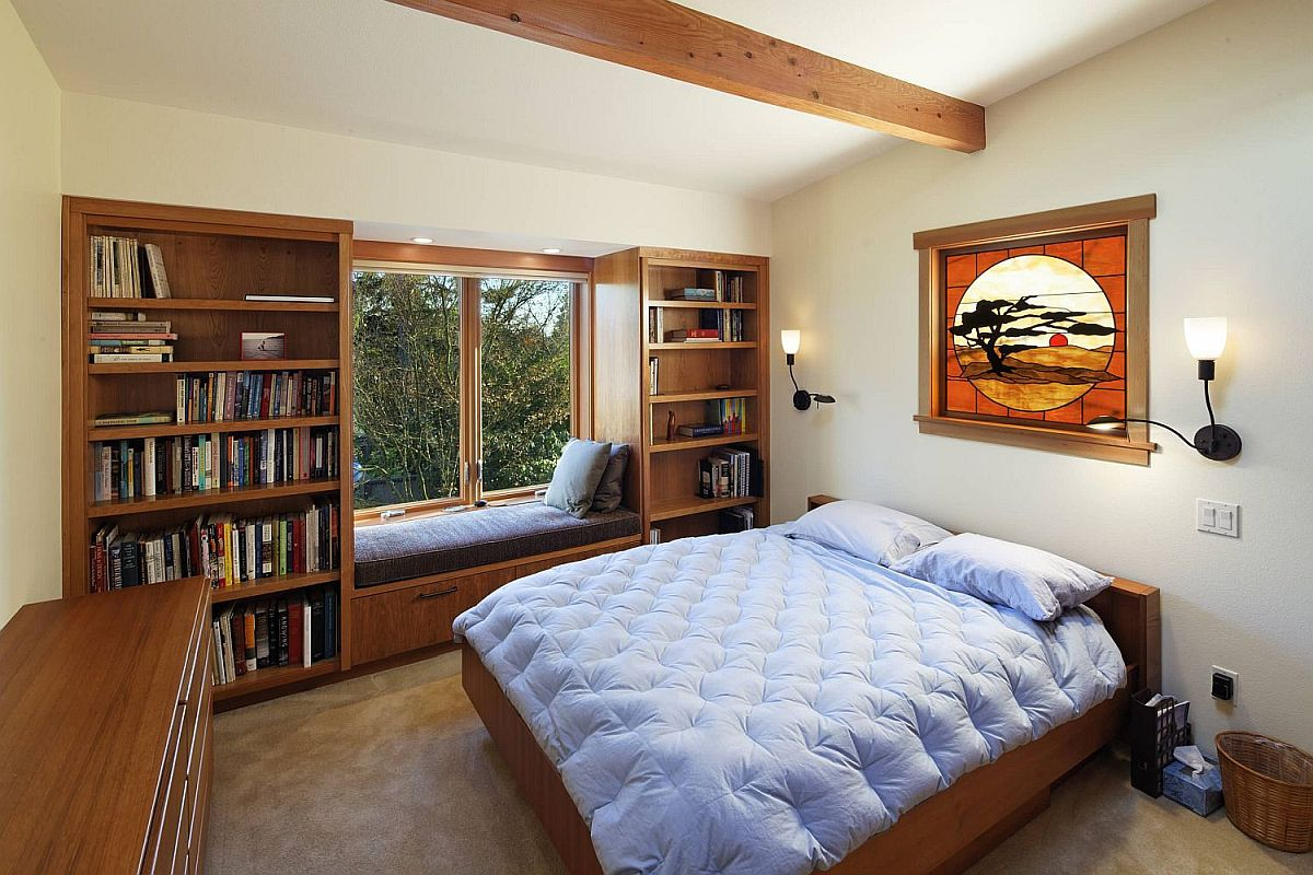 Create your own custom window seat with built-in storage and bookshelves all around for a perfect reading nook