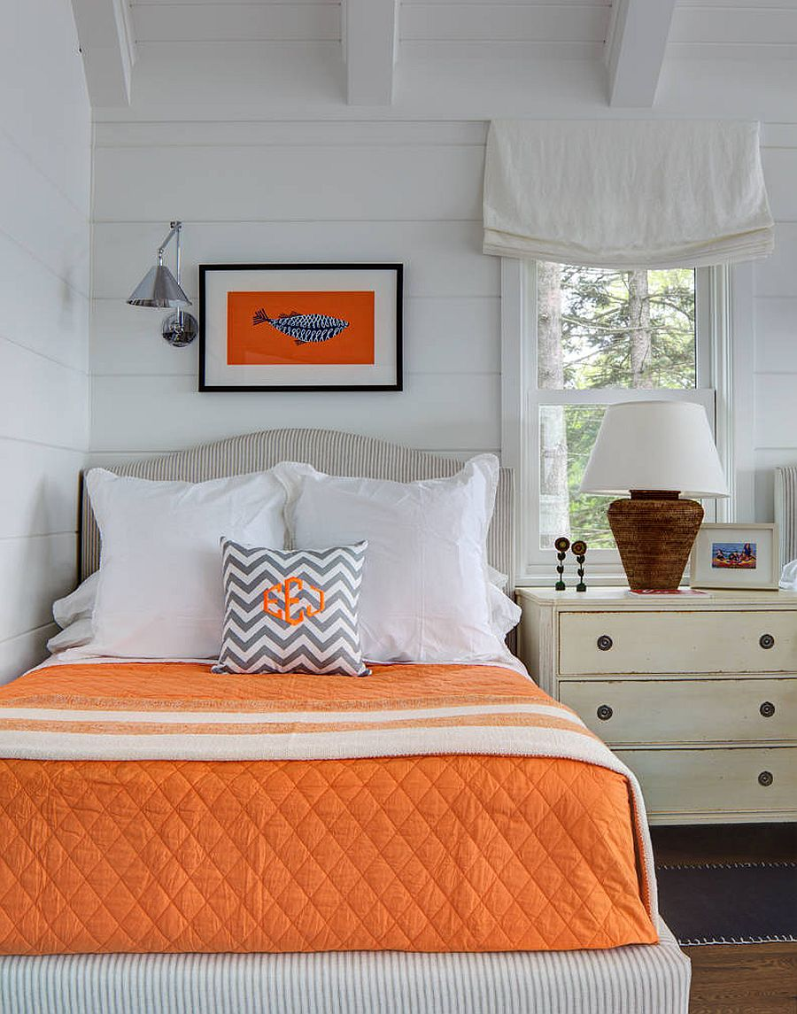 Creative use of orange accents in the modern coastal bedroom with a white backdrop