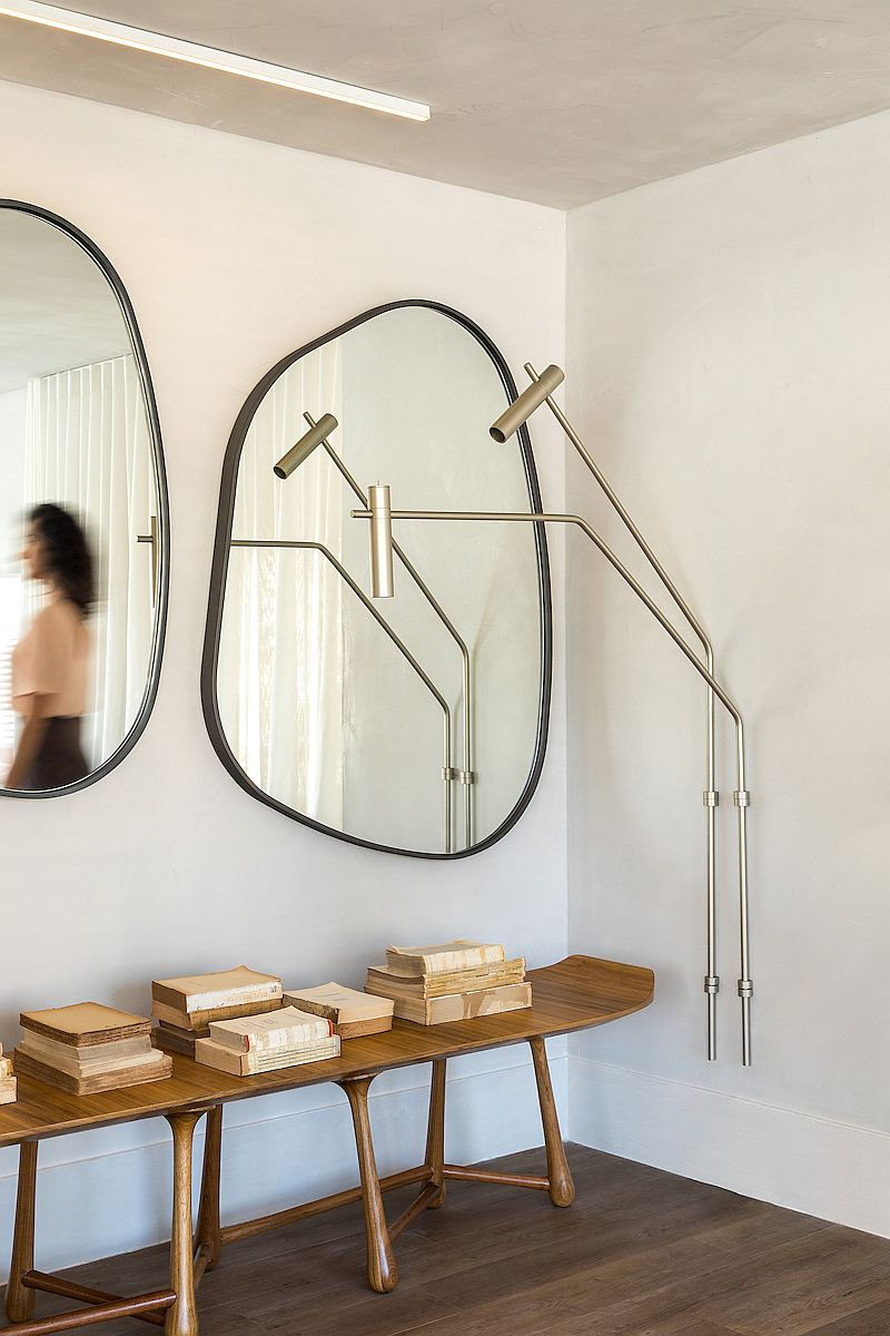 Creative use of slim console table and mirrors to decorate the hallway