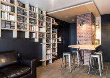 Creative-wooden-bookshelves-packed-with-books-make-the-biggest-impression-in-this-family-room-45902-217x155
