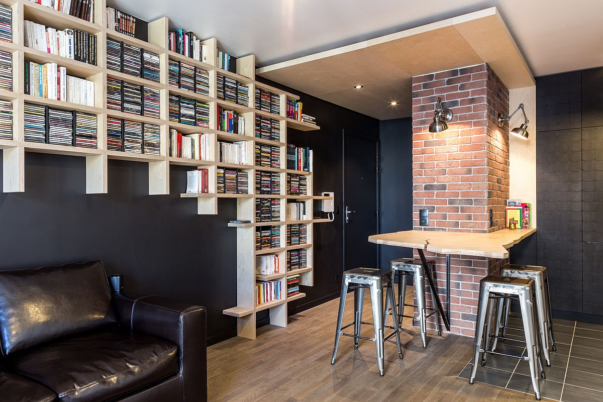 Creative wooden bookshelves packed with books make the biggest impression in this family room