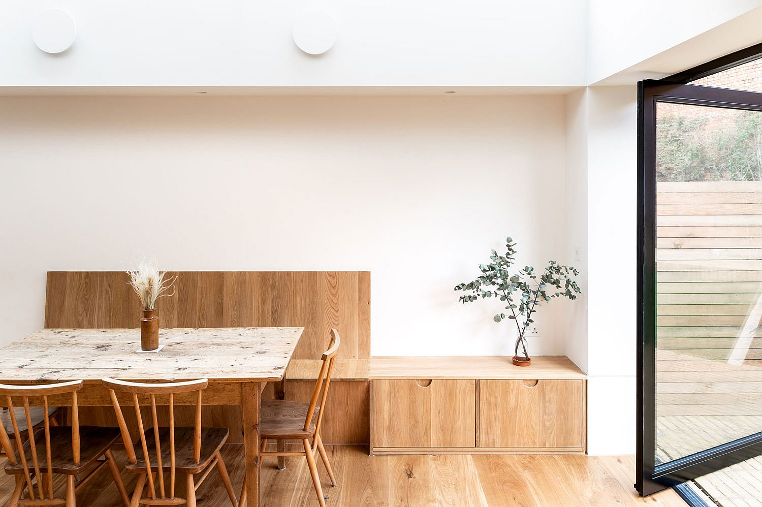 Custom wooden benches for the banquette-styled dining space inside the new kitchen
