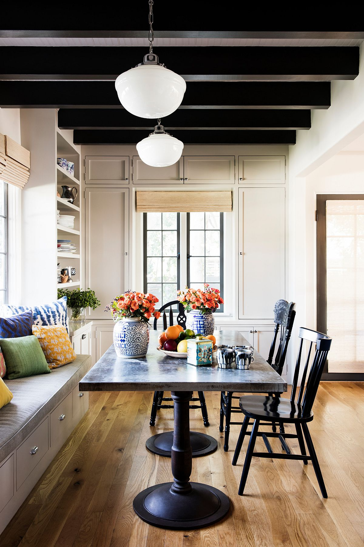 Dark-ceiling-beams-custom-built-in-bench-with-storage-and-large-windows-give-this-dining-space-a-modern-Mediterranean-vibe-70924