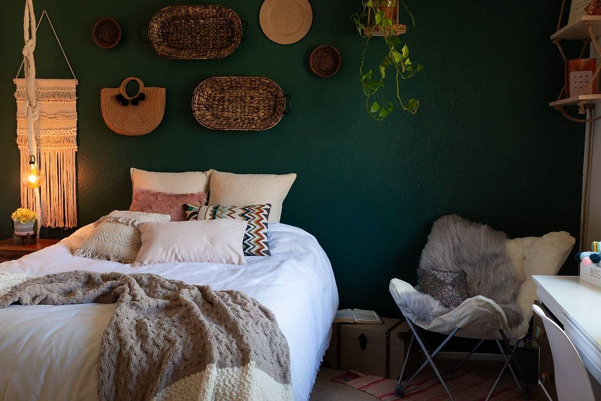 Dark walls, custom decor and unique textiles create a lovely bedroom with modern bohemian style