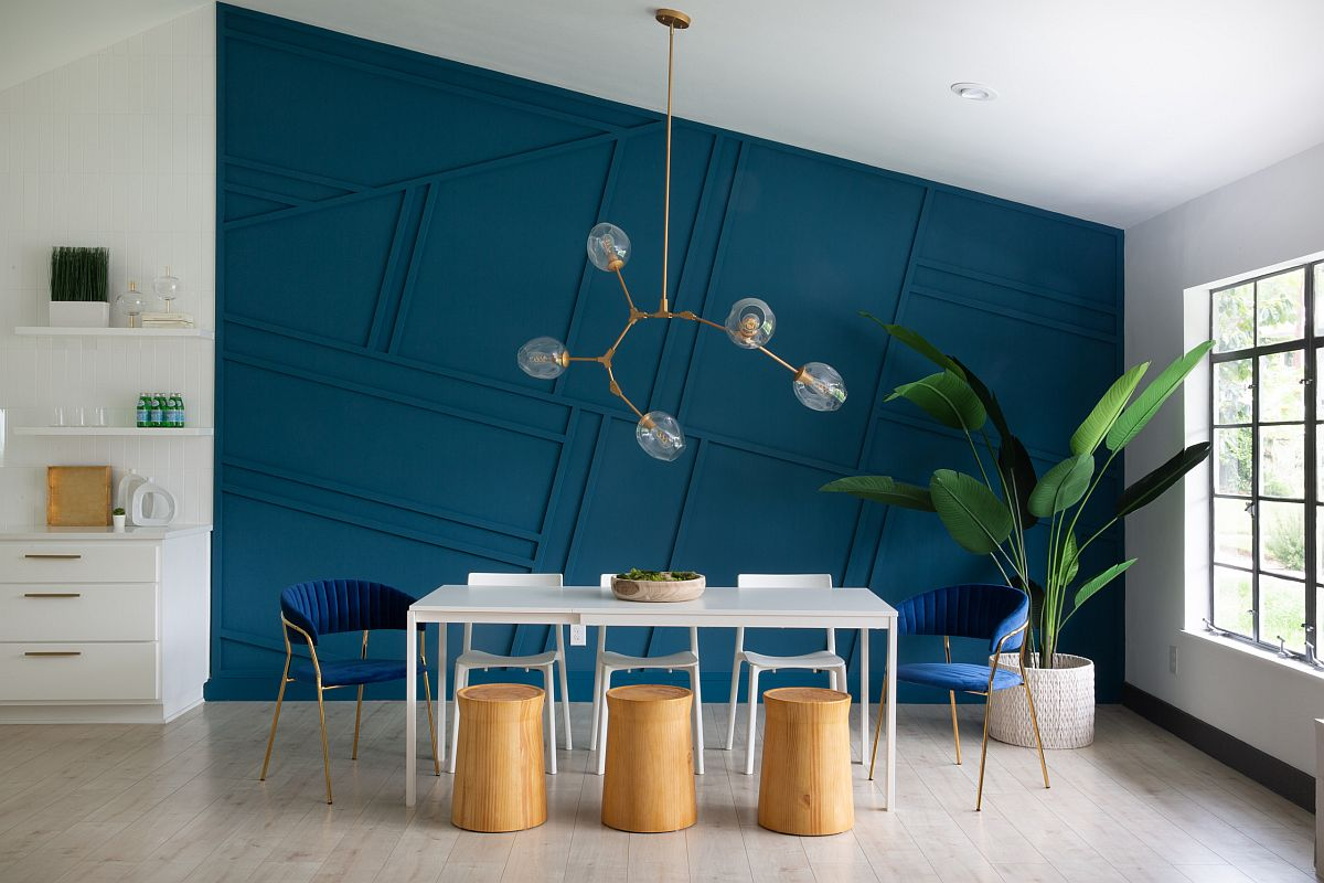 Dashing dark blue backdrop in the dining room also adds geometric style to the minimal space