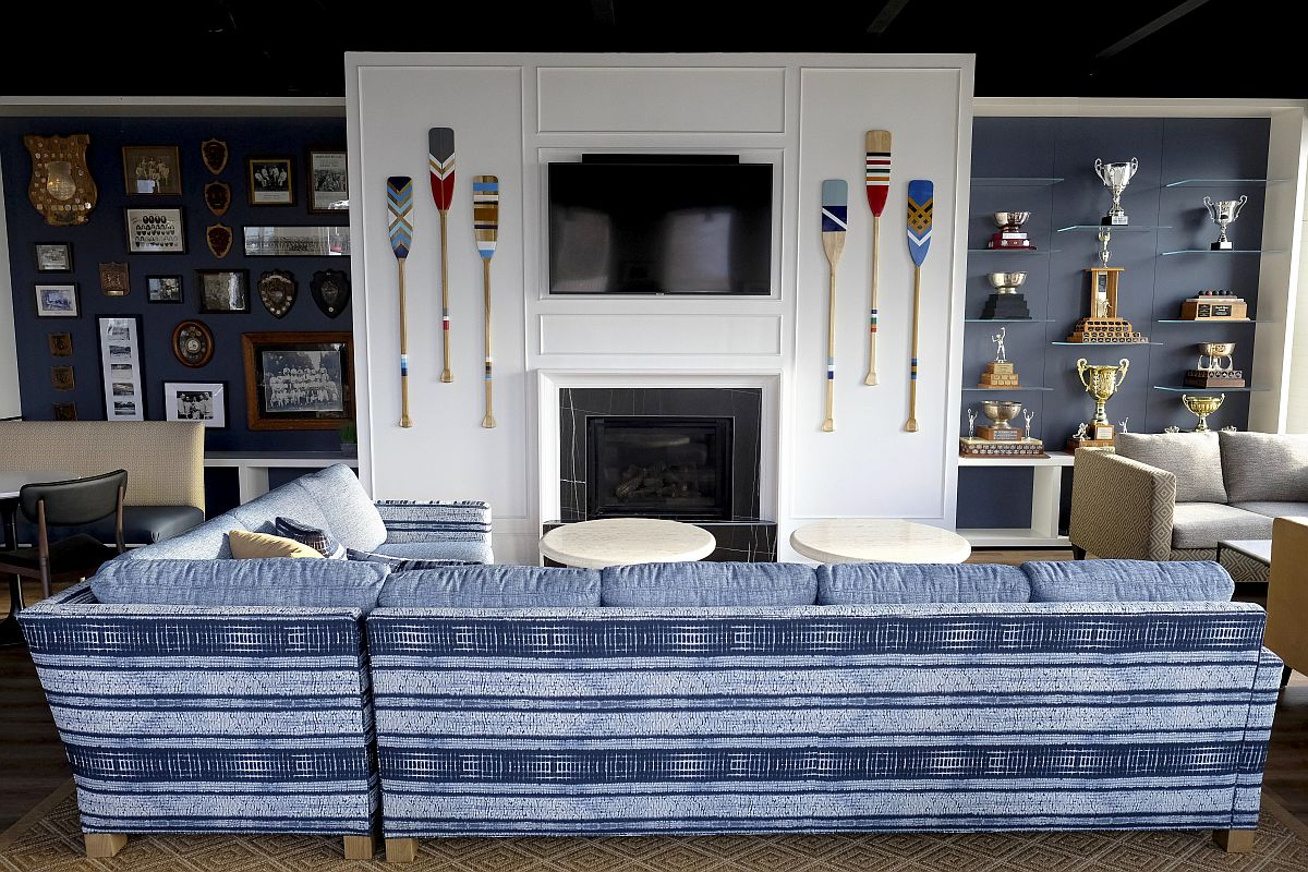 Decorating-the-space-around-the-fireplace-with-TV-paddles-and-memorabilia-33360