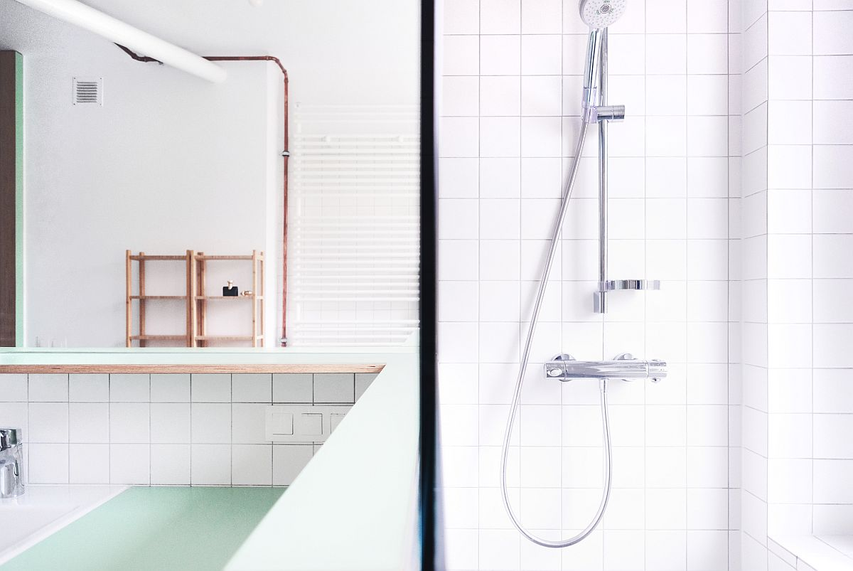 Delightful-light-filled-apartment-in-white-with-exposed-copper-pipes-that-add-metallic-glint-10200