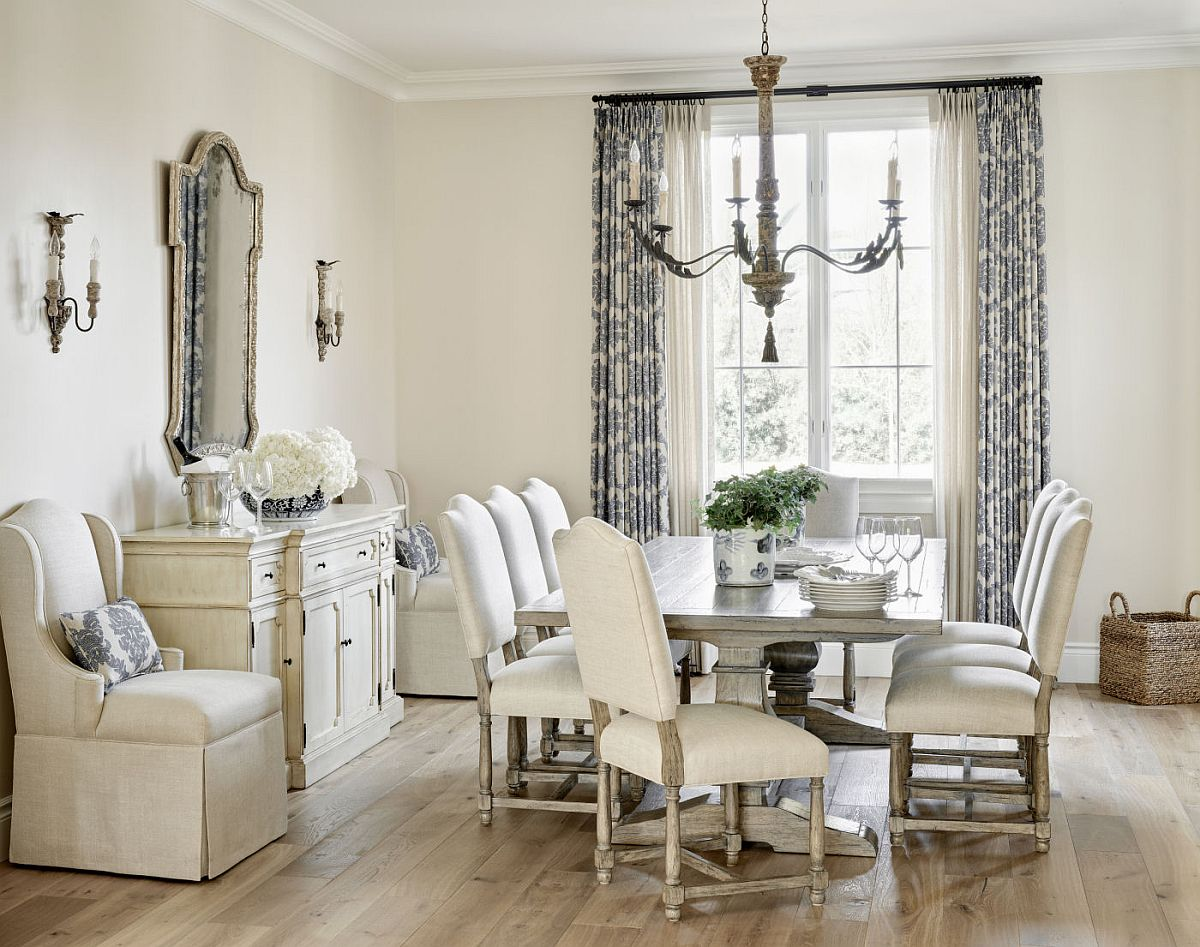 Design that picture-perfect dining room in white with drapes that feature light blue print and plenty of natural light