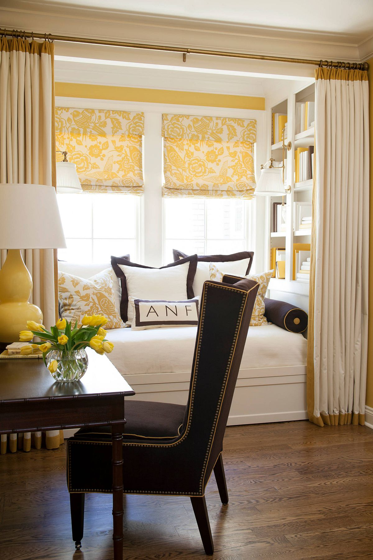 Drapes for the reading nook give a sense of privacy while delineating the space elegantly
