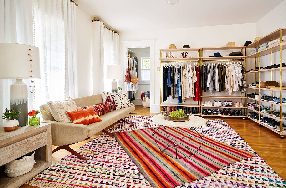 Eclectic closet with rugs that add pops of color and open metallic shelves for the wardrobe